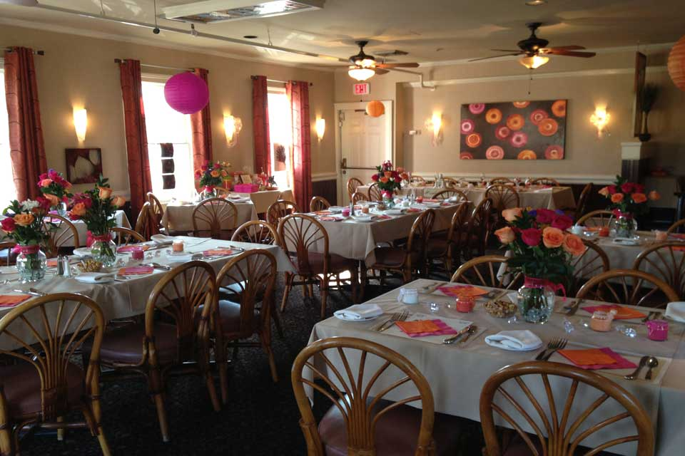 Tables and chairs prepared for a reception at Raintree Restaurant