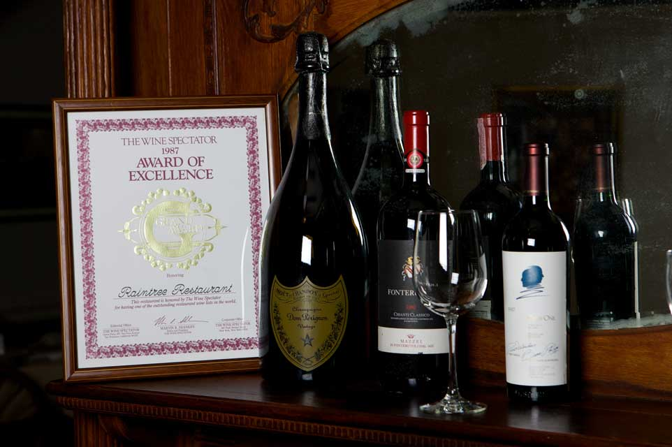 Wine bottles next to Raintree Restaurant award