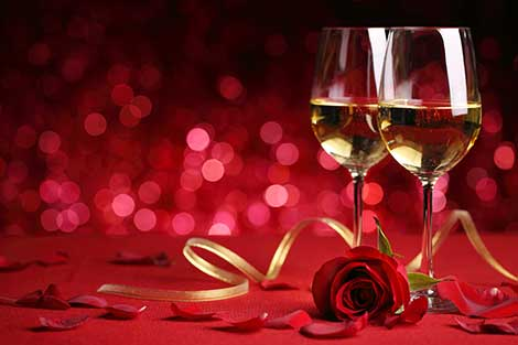 Wine glasses with a rose on a red background